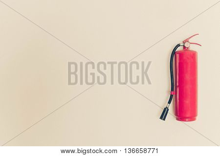 a red fire extinguisher hung on the wall