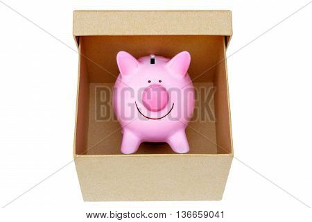 A pink piggybank in a cardboard box