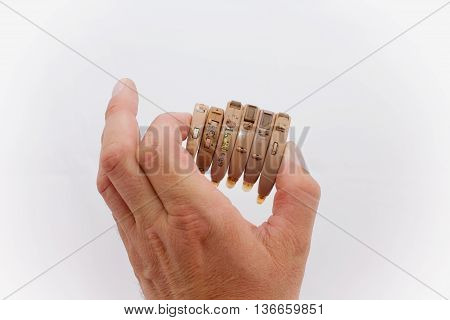 Hearing aids as electronic waste - hand shows a few obsolete and heavily used hearing aids