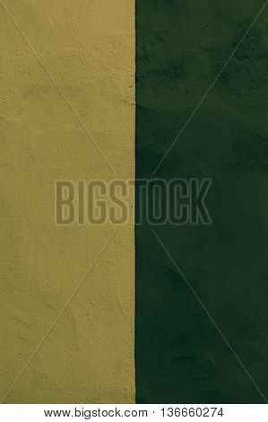 Half colored texture plaster wall exterior biege and dark green