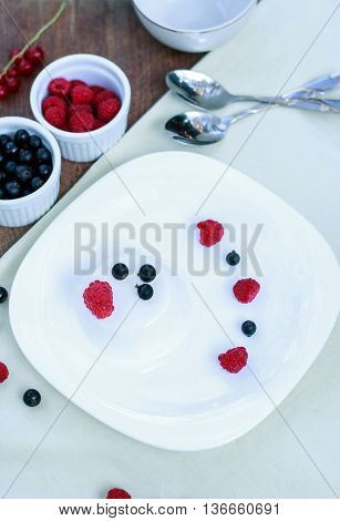 Beautiful Dessert Of Ice Cream And Berries. Red Currant, Black Currant, Raspberry And Banana. Table