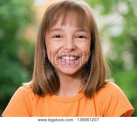 Happy little caucasian girl having fun at the park