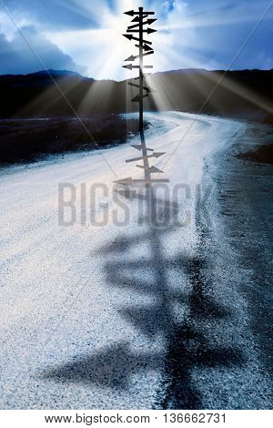 direction signs on road over sun rays.