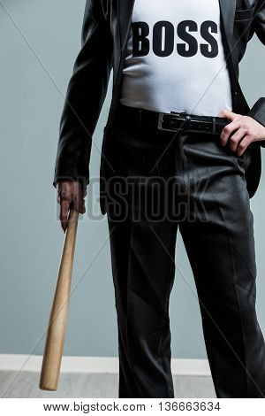 Business Boss Concept Holding A Baseball Bat