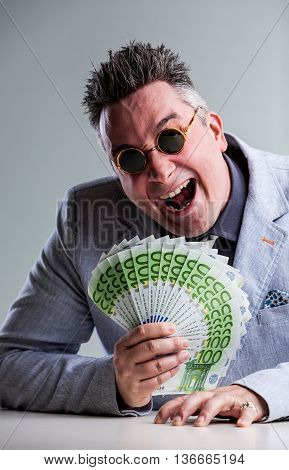 Crazy Buisnessman With Money And Sunglasses