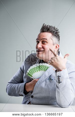 Weird And Bribing Businessman Laughing