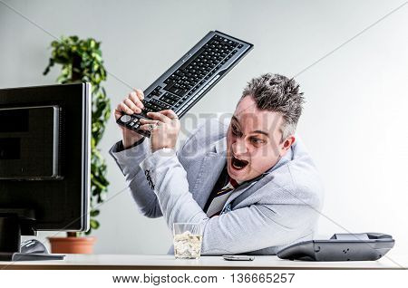 Office Worker Destroying His Computer