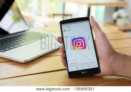 CHIANG MAI THAILAND - MAY 11 2016: Man hand holding LG G4 with screen shot of new Instagram application and new logo using LG G4. Instagram is largest and most popular photograph social networking.