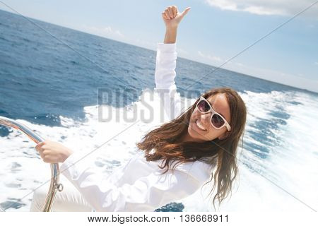 woman on the upper deck of a cruise ship