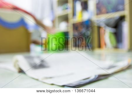 blur image background book shelf and interior decoration in home