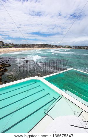 Bondi Beach from above the swimming pool at the Southern end of the beach. Bondi Beach is one of the worlds most famous beaches and is a highlight for many vistors to Sydney Australia.
