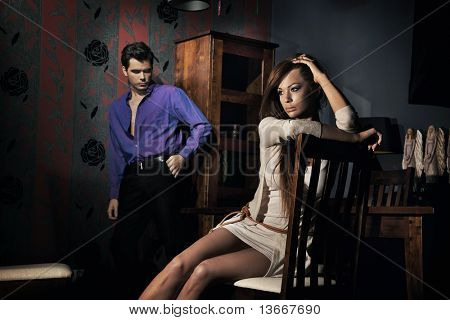 Squabbled couple in stylish apartment