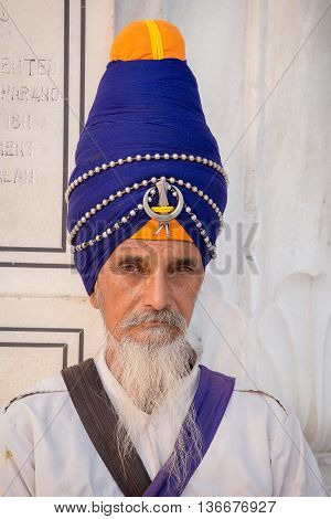 AMRITSAR INDIA - SEPTEMBER 27 2014: Unidentified Sikh man visiting the Golden Temple in Amritsar Punjab India. Sikh pilgrims travel from all over India to pray at this holy site.