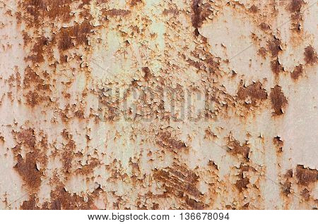 rusting metal which detaches the upper layer coating of pink paint background