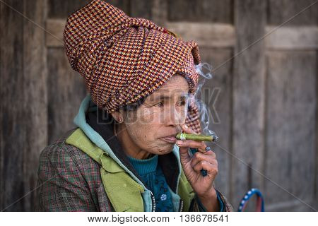 INLE LAKE MYANMAR - JANUARY 13 2016: Unidentified old woman in market. The local people are hospitable and friendly to tourists