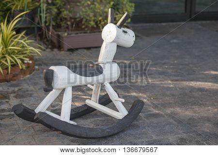 Children toy of white wooden rocking horse chair
