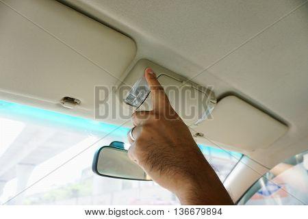 finger hitting car light man pressing button.