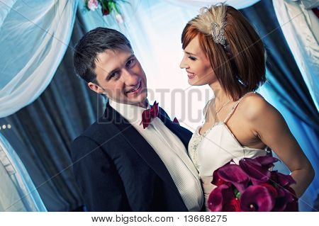 Close-up of an attractive couple on their wedding day