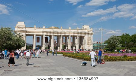 Moscow - May 9 2016: People walk in Gorky Park near the main entrance to the park and beautiful flower beds with tulips May 9 2016 Moscow Russia