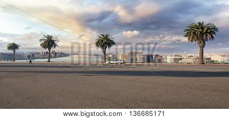 cityscape and skyline of hangzhou riverside new city in cloud sky on view from empty street