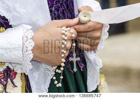 CAGLIARI, ITALY - May 1, 2016: 360 ^ Sant'Efisio Festival - Sardinia - especially jewelry worn by a girl in traditional Sardinian costume