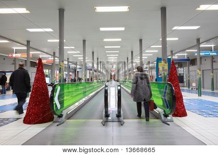 PARIS - DECEMBER 29: Hall with horizontal escalator at CDG airport, decorated with Christmas trees, December 29, 2009, Paris, France. This airport is principal one of France, one of two main airports