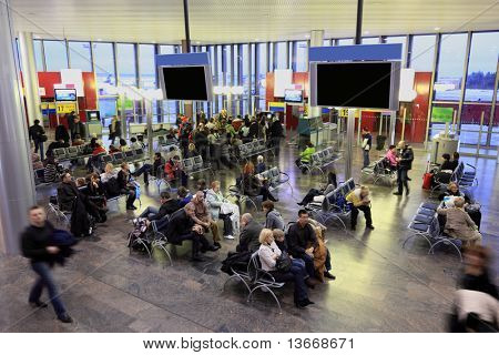 MOSCOW - DECEMBER 29: People in waiting room at airport Sheremetyevo, December 29, 2009, Moscow, Russia. Sheremetyevo - one of largest Russian airports on number of scheduled international traffic