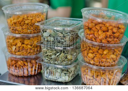 Portions of spicy and salty seeds snacks for beer parties