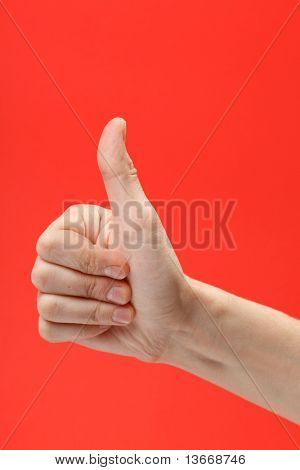 human hand showing sign of okay