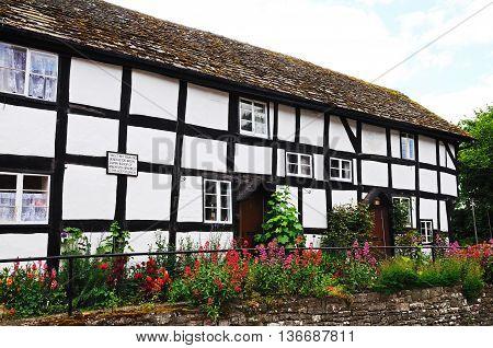 PEMBRIDGE, UNITED KINGDOM - JUNE 5, 2014 - Old former white timber framed cottage hospital along Bridge Street Pembridge Herefordshire England UK Western Europe, June 5, 2014.