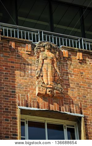 Sculptured brickwork detail on the front of the Royal Shakespeare Theatre Stratford-upon-Avon Warwickshire England UK Western Europe.