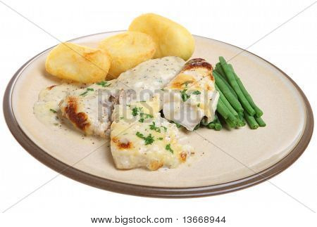 Baked haddock fish with cheese sauce, green beans and roast potatoes.
