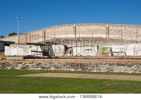 FREMANTLE,WA,AUSTRALIA-JUNE 1,2016:  Outdoor yard with limestone boundary walls at the Fremantle Prison in Fremantle, Western Australia.