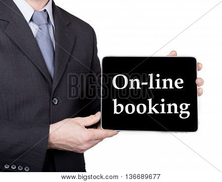 technology, internet and networking in tourism concept - businessman holding a tablet pc with on-line booking sign. Internet technologies in business and traveling. isolated on white backgroung.