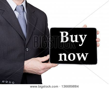 technology, internet and networking in tourism concept - businessman holding a tablet pc with buy now sign. Internet technologies in business and traveling. isolated on white backgroung.