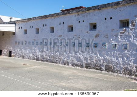 FREMANTLE,WA,AUSTRALIA-JUNE 1,2016:  Numbered exterior painted limestone wall at the Fremantle Prison in Fremantle, Western Australia.