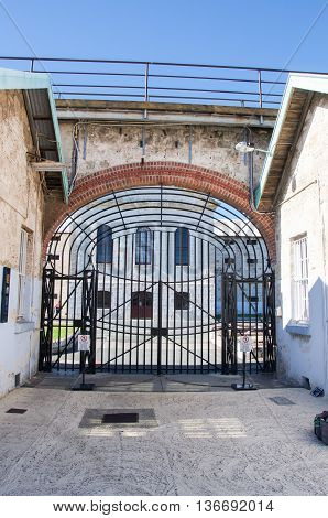 FREMANTLE,WA,AUSTRALIA-JUNE 1,2016:  View through the gate house's arched gateway at the Fremantle Prison in Fremantle, Western Australia.