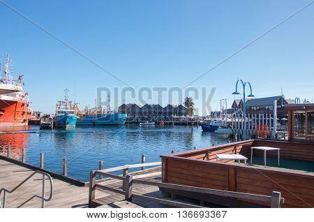 FREMANTLE,WA,AUSTRALIA-JUNE 1,2016:Fremantle Fishing Boat Harbour and water front restaurants under a clear blue sky in Fremantle, Western Australia.