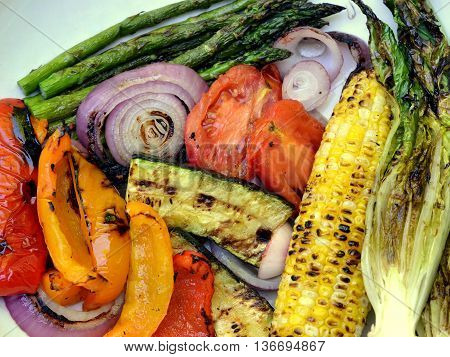 Grilled Vegetables: asparagus, red onion, bell peppers, corn, plum tomatoes, zucchini and romaine lettuce.