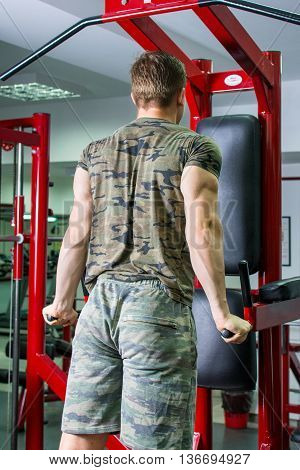 Man Performing Chest And Triceps Workout At Gym