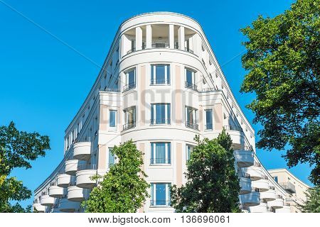 Modern white multi-family house seen in Berlin, Germany