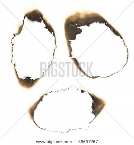 Burned holes in white paper. Design elements.