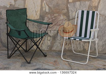 Deck chair and straw hat with summer
