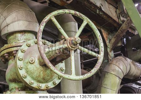 Industrial rusty valve in an abandoned factory