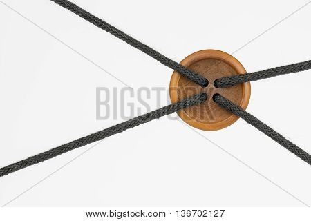 Big clothing button with ropes as conceptual node