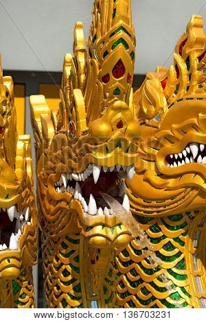 Detail of a fountain with golden dragons in Thailand