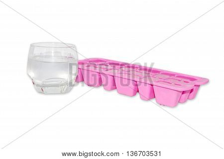 Colorful plastic ice tray and glass isolated on white background.