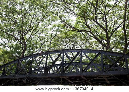perspective view of Death railway bridge across Kwai river Kanchanaburi Thailand