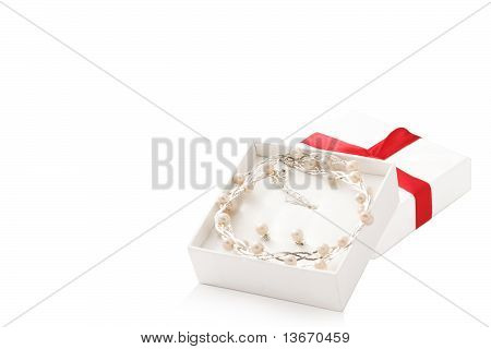 Opened White Box With Pearls