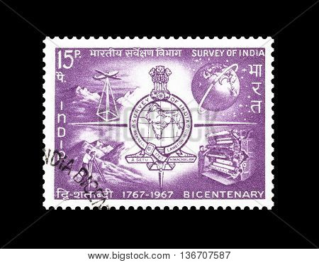 INDIA - CIRCA 1967 : Cancelled postage stamp printed by India, that shows Emblem of Survey of India.